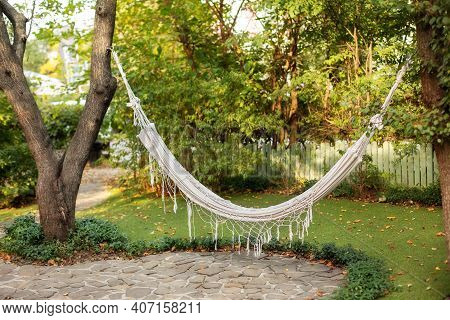 Comfortable Hammock Hanging Hanging On Tree In Summer Garden. Cozy Hygge Place For Weekend Relax In