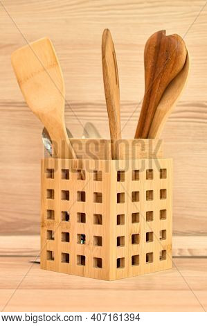 Wooden Cutlery, Bamboo Spatulas And Spoons In Wooden Basket On Beige Kitchen Countertop. Beige Kitch