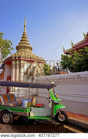 Tuk-tuk Taxi In Front Of The Temple Of The Reclining Buddha, Bangkok Old Town, Historic Place In Tha
