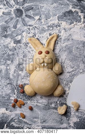 Raw Easter Bunny Buns Of Delicious Sweet Dough On A Table Sprinkled With Flour, Top View