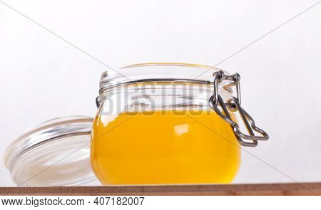 Ghee (clarified Butter) In The Glass Jar Against The White Background. Ingredient Used In Indian And