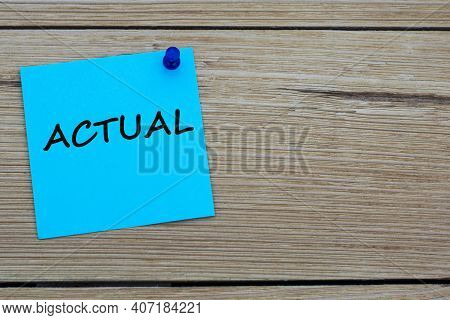 Actual Is An Word Written On A Blue Sheet Attached To A Wooden Board. Busines Concept. Keep It Simpl