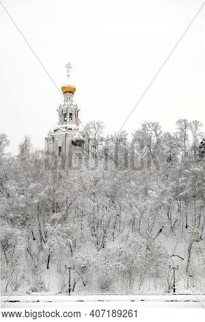 Winter Landscape With Russian Church On The Hill And Frozen Forest Under It In The Gray Overcast Day
