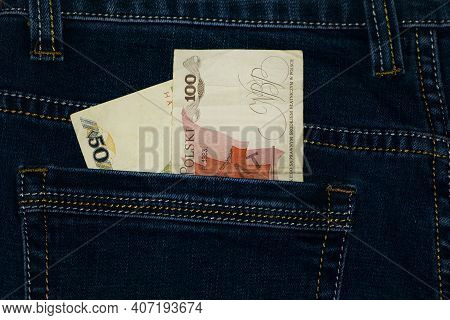 Polish Zlotys. Bills Of 100 And 50 Zlotys In The Pocket Of Your Trousers. Jeans Pants, Money In My P