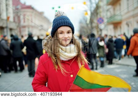 Cute Young Girl Celebrating Lithuanian Independence Day Holding Lithuanian Flag In Vilnius, Lithuani