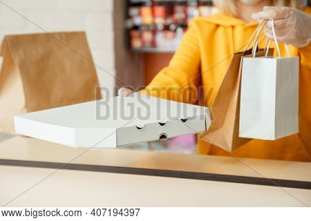 Pizza To Go, Takeaway Pizza Coffee, Food Delivery. Woman In Gloves Work With Takeaway Orders. Waiter