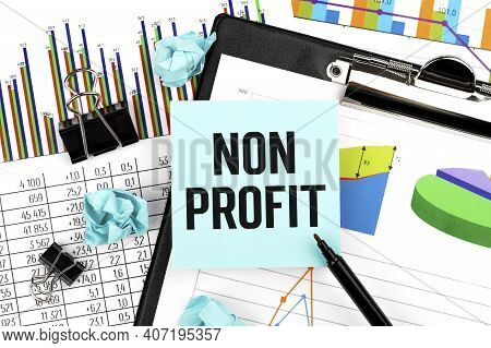 Word Non Profit On Stickers. Clipboard With Charts, Pen And Stationery On Office Desk. Accounting Co