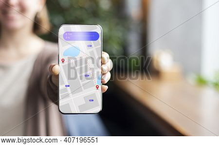 Unrecognizable Woman Showing Cellphone With Navigation App To Camera Standing Indoors. Gps Navigatio