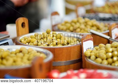 Assorted Organic Pickled Olives, Garlic, Hot Peppers, Capers And Sundried Tomatos Sold On A Marketpl
