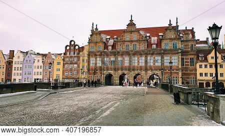 Gdansk, Poland - February 7, 2021: Beautiful Colorful Townhouses On The Banks Of The Frozen Motlawa