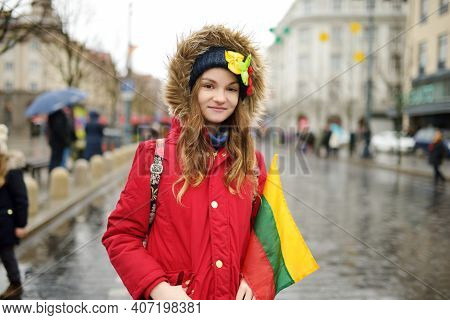 Cute Young Girl Celebrating Lithuanian Independence Day Holding Tricolor Lithuanian Flag In Vilnius,