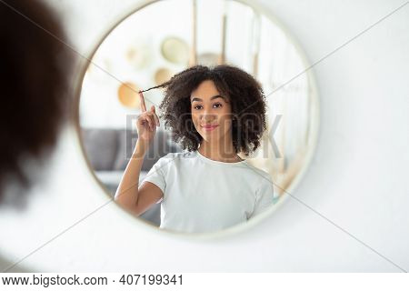 Great Hairstyle, Perfect Strand And Positive. Happy Millennial African American Female Holds Curly H