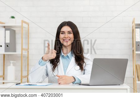 Telemedicine, Medical Online, Ehealth, Video Call And Chat. Portrait Of Female Doctor In White Coat