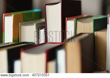 This Is A Lot Of Books Standing Together In Several Rows. Solid Background Of Books In Close-up. The