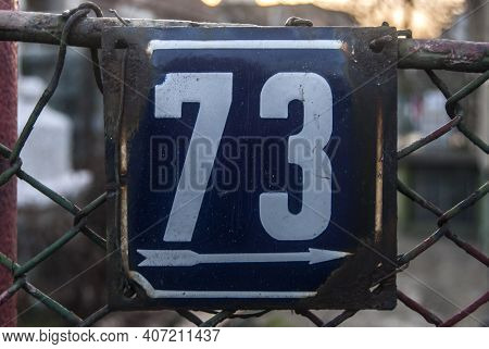 Weathered Grunge Square Metal Enamelled Plate Of Number Of Street Address With Number 73