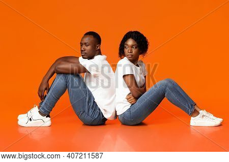 Difficulties In Marriage. Upset African American Young Lady Looking At Her Sad Boyfriend, Black Coup