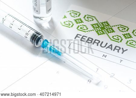 New York, United States - February 8 2021: Syringe, Vial And Calendar With Month Of February On A Wh