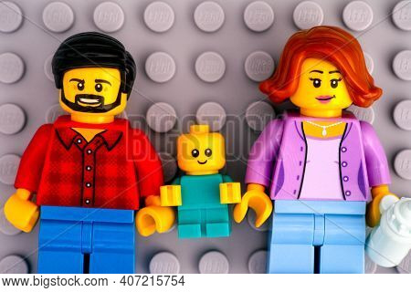 Tambov, Russian Federation - January 17, 2021 Lego Family - Father, Mother And Baby Minifigures On G