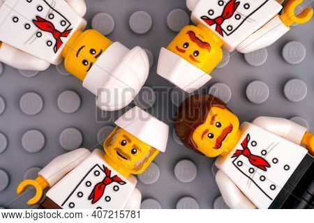 Tambov, Russian Federation - January 17, 2021 Four Lego Chef Minifigures Against Gray Baseplate Back