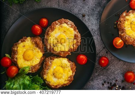 Beefsteak With Egg On A Plate. Delicious Hot Dish. The Dish Is Decorated With Cherry Tomatoes And He