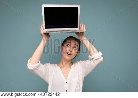 Beautiful Smiling Happy Young Woman Holding Computer Laptop Looking Up At Netbook Having Fun Wearing