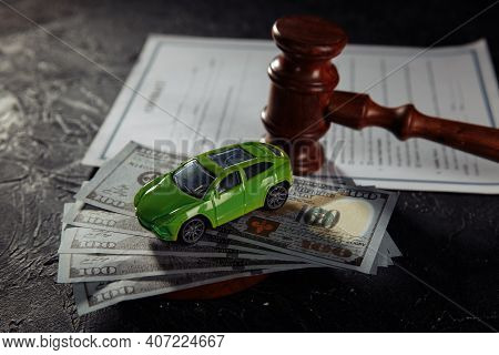 Car And Wooden Judge Gavel. Concept Of Selling A Car By Auction Or Accident Sentence