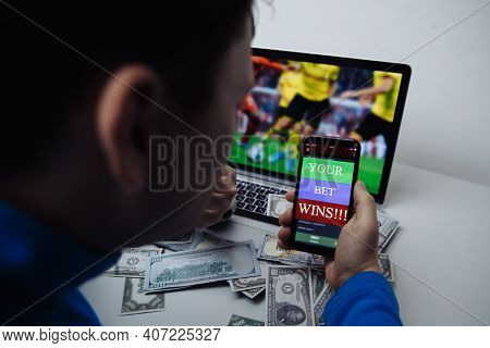 Man Watching Football Match Online Broadcast On His Laptop And Celebrate After Winning Result