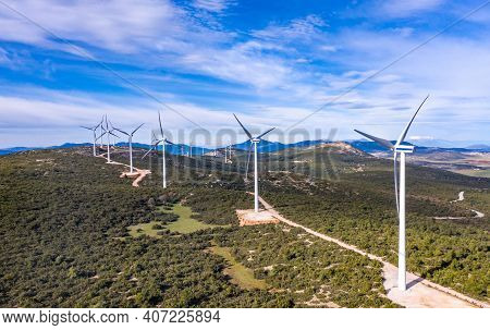 Wind Turbines, Renewable Energy On A Green Hill. Wind Farm