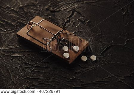 Mousetrap With A Bait In The Form Of Pills. Addiction And Dependence On Drugs Concept