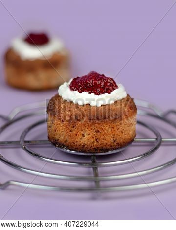 Traditional Finnish Pastry Runeberg Torte. Runebergin Torttu. On Purple Rose Color Background