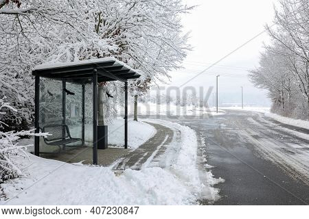 Bus Stop By The Snowy Road In Winter