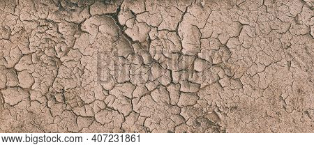 Background Of Brown Dry Cracked Soil Dirt Or Earth During Drought. Dry Cracked Earth Depicting Sever