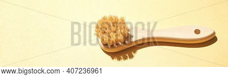 Wood Face Brush On Yellow Background. Trendy Hard Shadow. Sunny Bath Device. Natural Eco Skin Care.