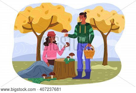 Young Couple Is Picking Mushrooms In The Forest. Outdoor Activity. Male And Female Mushroomers Pick