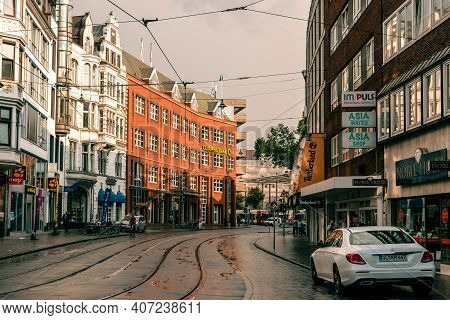 Bremen, Germany - August 5, 2019: Tramway Through Street In Historic Centre A Rainy Day Of Summer