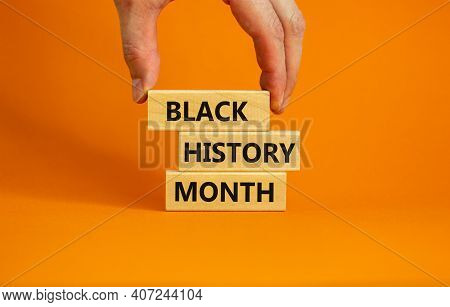 Black History Month Symbol. Wooden Blocks With Words 'black History Month'. Beautiful Orange Backgro