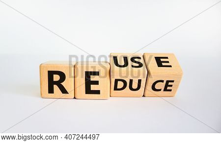 Reuse Or Reduce Symbol. Turned Wooden Cubes And Changed The Words Reduce To Reuse. Beautiful White B
