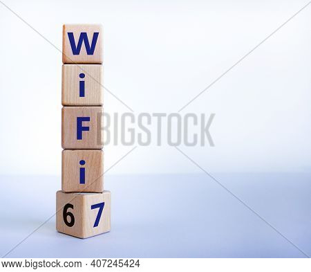 Wifi 6 Or 7 Symbol. Turned A Wooden Cube And Changed The Words Wifi 6 To Wifi 7. Beautiful White Bac