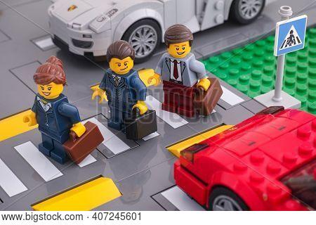 Tambov, Russian Federation - February 07, 2021 Lego Businesspeople Minifigures Crossing The Road Usi
