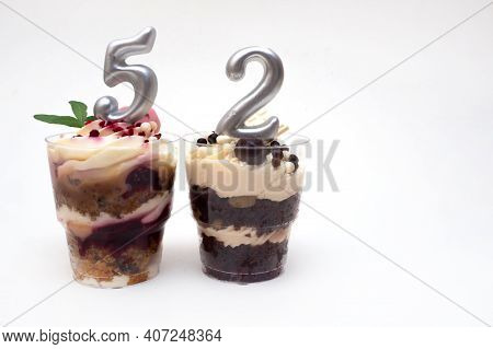 Birthday Trifle Cake With Candle Labeled Number 52 On White Background With Copy Space. Portioned Mi