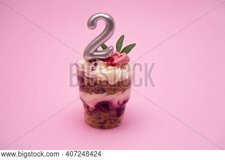 Birthday Trifle Cake With Candle Labeled Number 2 On Pink Background. Portioned Mini Cake