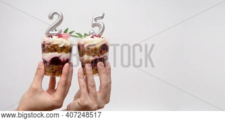 Birthday Trifle Cake With Candle Labeled Number 25 In Hand On White Background With Copy Space. Port