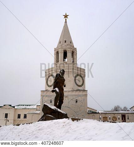 Kazan, Russia - January 09 2021: Spasskaya Tower Of The Kazan Kremlin And Monument Of The Soviet Tat