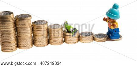 Expenses For The Child, Payments, Alimony. On The Calculator Coins And Children's Toys. Top View, Vi