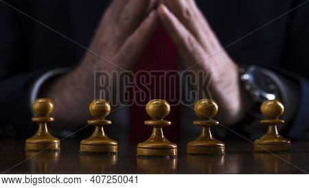 Concept Of Strategy And Business Planning, Businessman At The Chessboard In Front Of Lined Up White