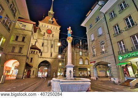 Bern, Switzerland - Aug 23, 2020: Night Urban Scene Of Kafigturm Tower, A Medieval Watchtower And An