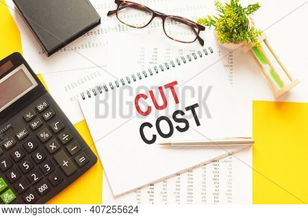 Writing Text Showing Cut Cost. Writing Text Cut Cost On White Paper Card, Red And Black Letters, Yel