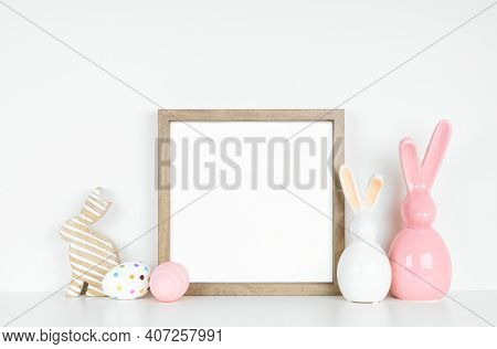 Mock Up Wood Frame With Easter Egg And Bunny Decor On A White Shelf. Square Frame Against A White Wa