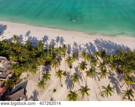 Aerial Top View On Paje Beach With Palm Trees Shadows At Evening Time. Paje Village, Zanzibar, Tanza