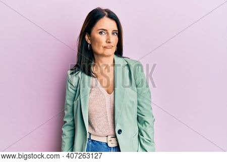 Middle age brunette woman wearing casual clothes depressed and worry for distress, crying angry and afraid. sad expression.